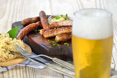 Sausages with sauerkraut and beer Stock Photos