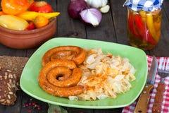 Sausages and sauerkraut Stock Image