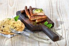 Sausages with sauerkraut Stock Images
