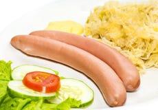 Sausages with sauerkraut Royalty Free Stock Photos