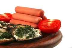 Sausages served on wooden plate Royalty Free Stock Photography
