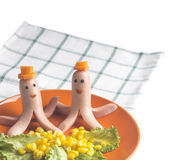 Sausages in the shape of octopus hats carrot on an orange plate Royalty Free Stock Photography