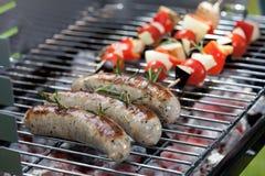 Sausages and shashliks Stock Photos
