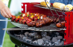 Sausages, shiskebabs and corns on the grill Royalty Free Stock Images