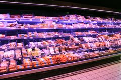 Sausages in shop. Wide selection of meat products in supermarket Stock Photos