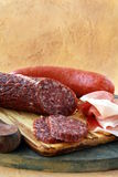 Sausages and smoked meats. On a cutting board Stock Images