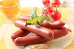 Sausages and spicy mustard Royalty Free Stock Images