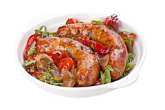 Sausages with stewed  vegetables Stock Photography