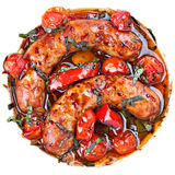 Sausages with stewed  vegetables Stock Image