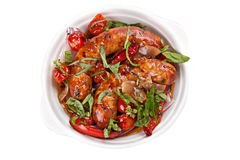 Sausages with stewed  vegetables Royalty Free Stock Photography