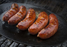 Sausages. Tasty and hot grilled sausages Royalty Free Stock Images
