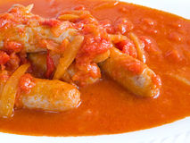 Sausages in tomato sauce. Stock Image