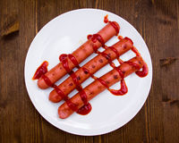 Sausages with tomato sauce from wooden Royalty Free Stock Photos