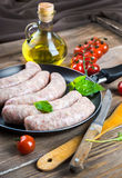 Sausages with tomatoes and arugula Stock Photography