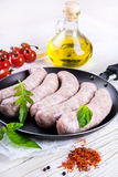 Sausages with tomatoes Royalty Free Stock Photography