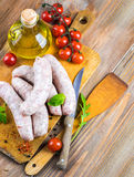 Sausages with tomatoes Stock Images