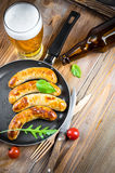 Sausages with tomatoes Stock Photography
