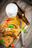 Sausages with tomatoes Royalty Free Stock Photo