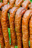 Sausages in a traditional smoker. Homemade sausages in a traditional smoker Stock Image