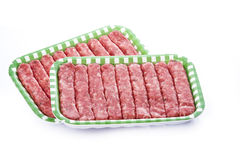 Sausages in a tray isolated on a white background Stock Photo