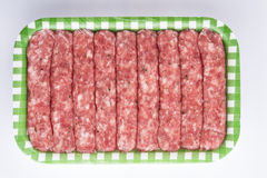 Sausages in a tray isolated on a white background Royalty Free Stock Photos