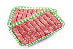 Sausages in a tray isolated on a white background Royalty Free Stock Images