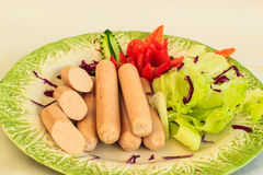 Sausages with vegatable on plate. Royalty Free Stock Photo