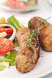 Sausages with vegetable salad Stock Photos