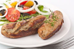 Sausages with vegetable salad Royalty Free Stock Image