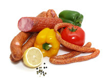 Sausages and vegetables Stock Images