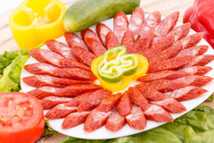 Sausages and vegetables. Fresh sausages and vegetables closeup picture Royalty Free Stock Image