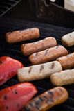 Sausages and vegetables on the grill Stock Image