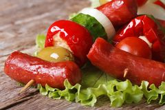 Sausages with vegetables on skewers macro horizontal Stock Photo