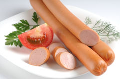 Sausages on a white background Stock Images