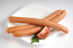 Sausages on a white background Stock Photos