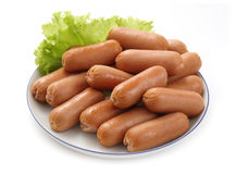 Sausages on a white dish Royalty Free Stock Images