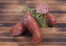 Sausages on wooden plate Stock Images