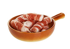 Sausages wrapped in bacon in a frying pan, chevapchichi on white Stock Photography