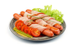 Sausages Wrapped in Bacon Royalty Free Stock Photos