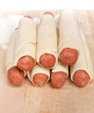 Sausages wrapped in raw puff pastry Royalty Free Stock Image