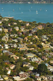Sausalito hillside homes and bay with sailboats, ferry Stock Images