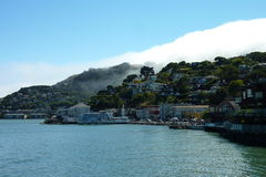 Sausalito. View of water, houses, and fog from the ferry Stock Photo
