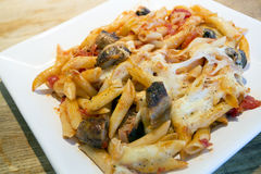Sausgae and tomato and mozzarella cheese pasta bake Royalty Free Stock Images
