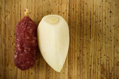 Sausge and garlic. Sausage and garlic on wooden background Stock Image