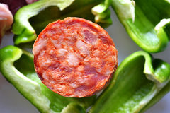 Saussage and green pepperoni Royalty Free Stock Images