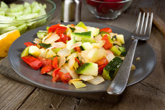 Sautéed grilled vegetables on old wooden Stock Photo
