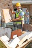 Saut de déchets de Putting Waste Into de constructeur photographie stock