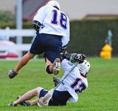 Saut de Lacrosse Photographie stock libre de droits