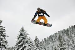 Saut de Snowboard Photographie stock