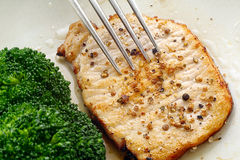 Sauté pork loin with pepper coriander and broccoli Stock Images